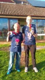 Rob Lickley and Phillip Craig proudly sport their medals and tee shirts